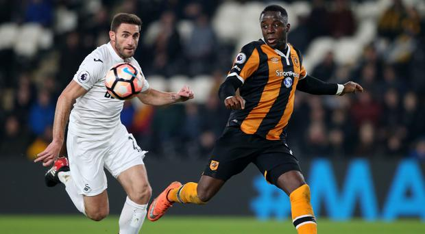 Hull City's Adama Diomande in action with Swansea City's Angel Rangel. Photo: Reuters