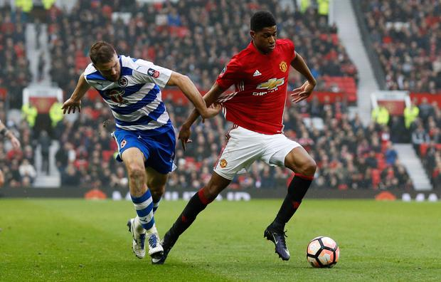 Manchester United's Marcus Rashford pulls away from Reading's Joey Van der Berg. Photo: Reuters