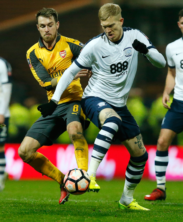 Arsenal's Aaron Ramsey and Preston North End's Simon Makienok battle for possession. Photo: Reuters