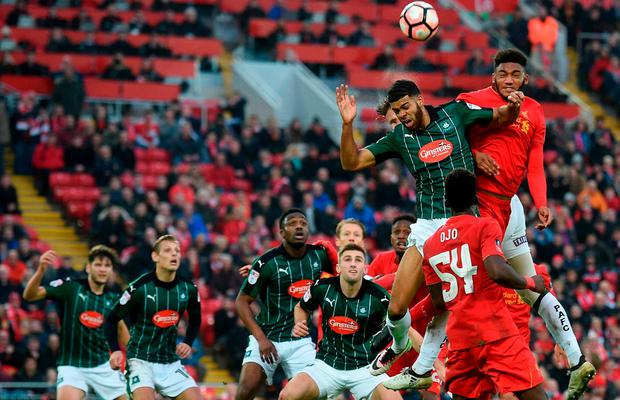 Liverpool's English defender Joe Gomez (R) jumps against Plymouth's English striker Jake Jervis to head the ball during the English FA Cup third round football match between Liverpool and Plymouth Argyle at Anfield