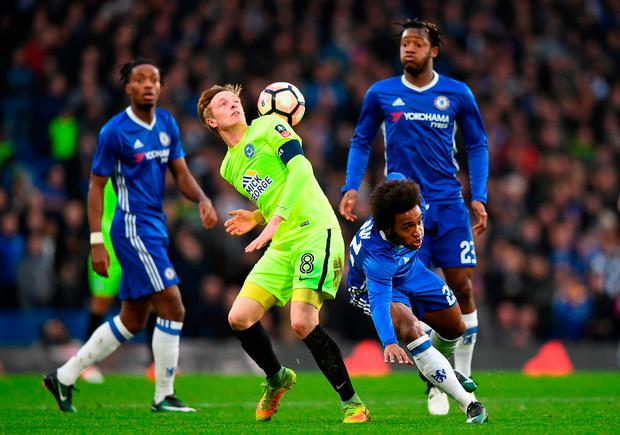 Chris Forrester of Peterborough United (L) and Willian of Chelsea (R) battle for possession