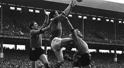 Mick O'Connell, centre, fields the ball over two opponents in the 1968 All-Ireland final against Down