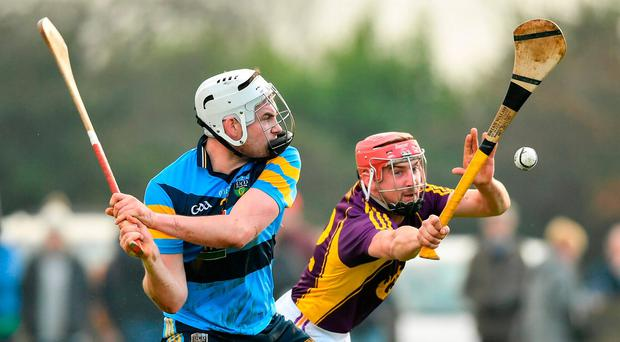 John O'Toole of UCD in action against Barry Carton of Wexford during the Bord na Mona Walsh Cup Group 3 Round 1 match between Wexford and UCD at Páirc Uí Suíochan in Gorey, Co. Wexford. Photo by Ramsey Cardy/Sportsfile