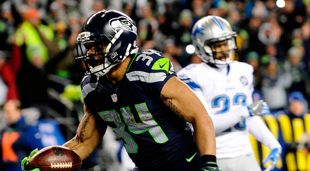 Seattle Seahawks running back Thomas Rawls (34) runs the ball in for a touchdown against the Detroit Lions. Photo: Steven Bisig/USA Today