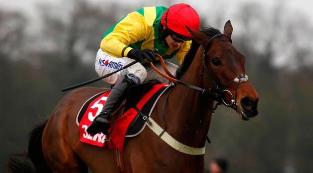 Finian's Oscar ridden by Tom O' Brien clears the last flight before going on to win The 32Red Tolworth Hurdle Race at Sandown. Photo: Julian Herbert/PA