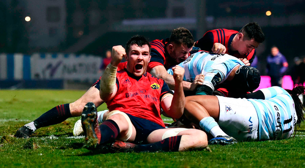 Munster captain Peter O'Mahony shows his delight as team-mate CJ Stander powers over for his side's second try against Racing 92 in Paris on Saturday Photo by Stephen McCarthy/Sportsfile
