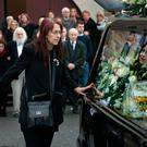 Siobhan MacGowan places her hand on the hearse. Photo: Tony Gavin