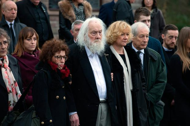 Therese's husband Maurice supported by family members. Photo: Tony Gavin