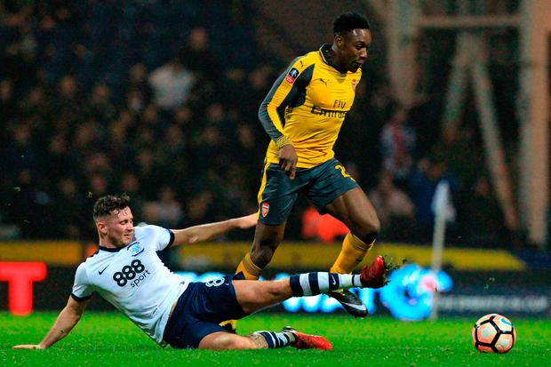 Alan Browne makes a sliding tackle on Danny Welbeck at Deepdale Picture: Getty