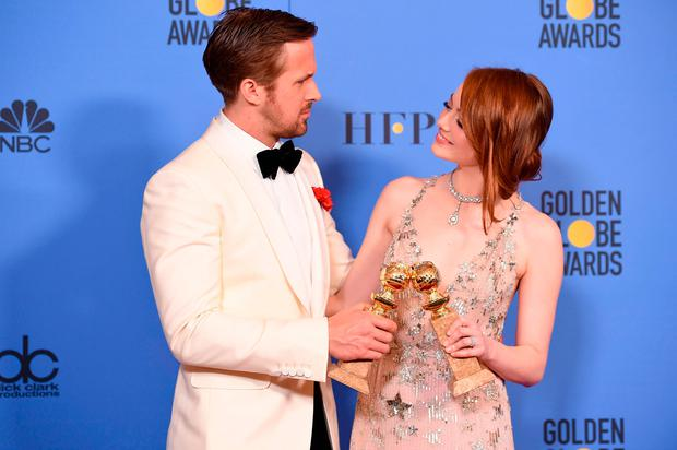 Actors Ryan Gosling and Emma Stone, winners of the Best Performance by an Actor/Actress in a Motion Picture ? Comedy or Musical for 'La La Land', pose in the press room at the 74th Annual Golden Globe Awards held