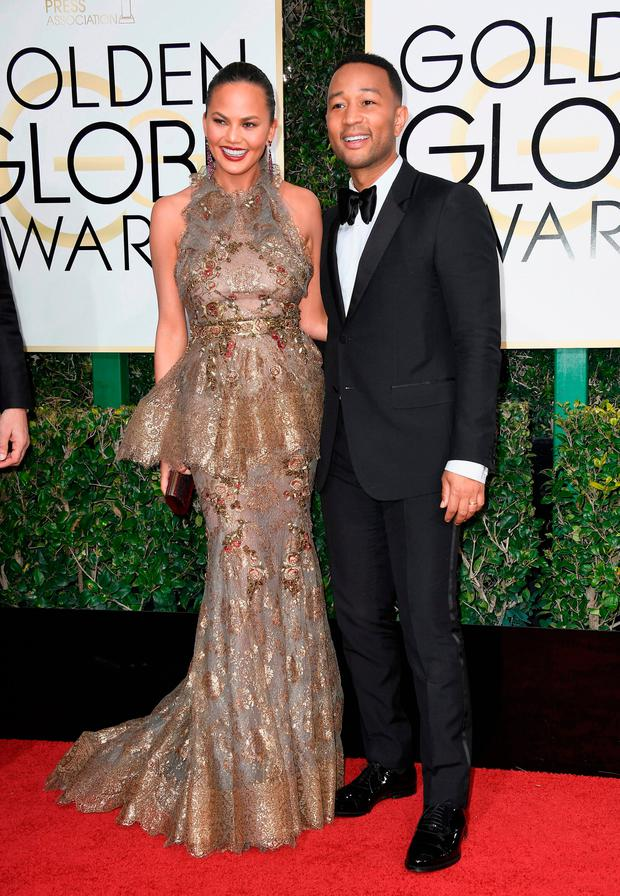 Chrissy Teigen and musician John Legend attend the 74th Annual Golden Globe Awards at The Beverly Hilton Hotel on January 8, 2017 in Beverly Hills, California. (Photo by Frazer Harrison/Getty Images)