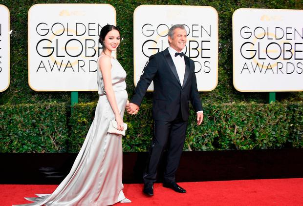 Writer Rosalind Ross and director/actor Mel Gibson attend the 74th Annual Golden Globe Awards at The Beverly Hilton Hotel on January 8, 2017 in Beverly Hills, California. (Photo by Frazer Harrison/Getty Images)