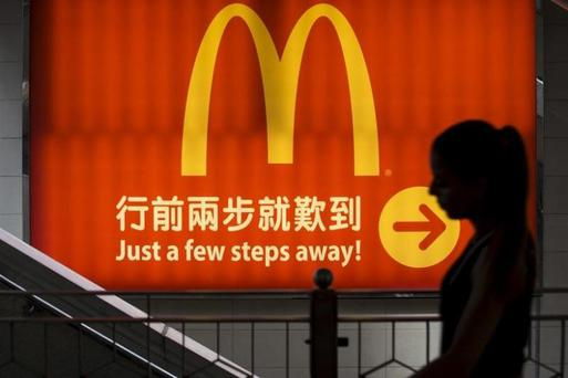 A woman walks past a McDonald's outlet in Hong Kong. REUTERS/Tyrone Siu/Files Photo