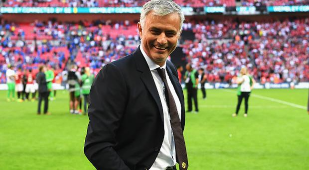 LONDON, ENGLAND - AUGUST 07: Manager of Manchester United, Jose Mourinho shares a smile after the final whistle during The FA Community Shield match between Leicester City and Manchester United at Wembley Stadium on August 7, 2016 in London, England. (Photo by Michael Regan - The FA/The FA via Getty Images)