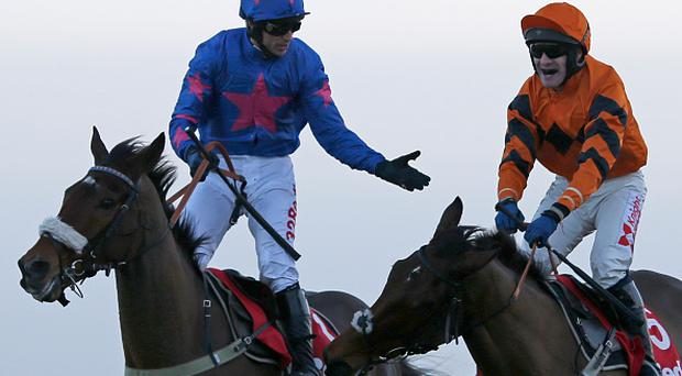 SUNBURY, ENGLAND - DECEMBER 26: Tom Scudamore riding Thistlecrack (R, orange) celebrates after winning The 32Red King George VI Steeple Chase from Cue Card and Paddy Brennan at Kempton Park on December 26, 2016 in Sunbury, England. (Photo by Alan Crowhurst/Getty Images)