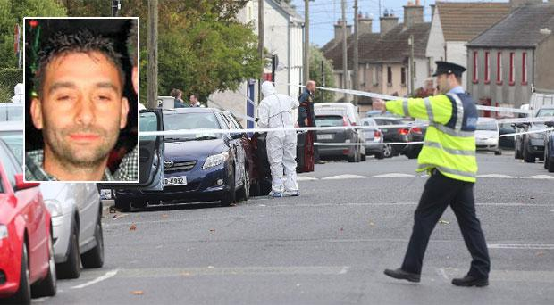 Gardai at the scene of the murder of Benny Whitehouse (inset).