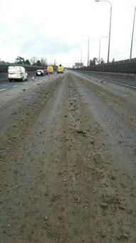 Motorists being advised to approach with care after dumper truck shed its load on the M50 near the Westlink toll bridge Source: (M50 Dublin Twitter)