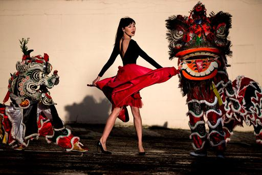 Model Yomiko Chen helped launch the Dublin Chinese New Year Festival with the help of a Lion and Unicorn. Photo: Mark Condren
