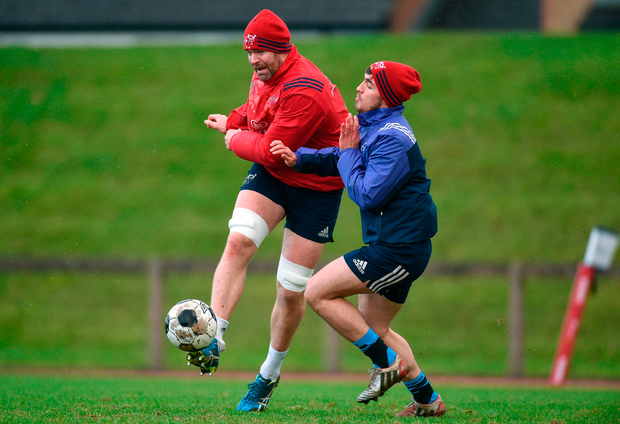 Billy Holland beats Greg O'Shea to the punch as Munster players try a different ball game. Photo by Diarmuid Greene/Sportsfile