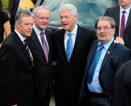 Peter Robinson, Martin McGuinness, Bill Clinton and John Hume pictured in 2010 Picture: Pacemaker
