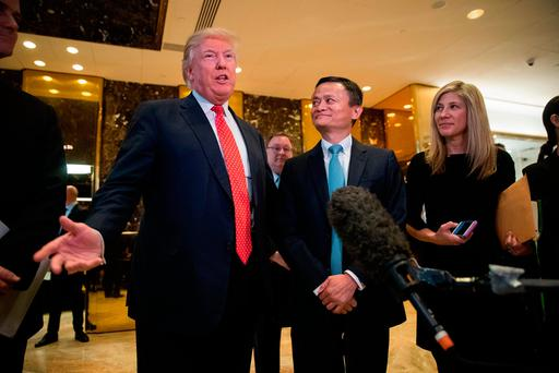 Donald Trump and Jack Ma, chairman of Alibaba Group, speak to reporters following their meeting at Trump Tower in New York City yesterday. Photo: Getty Images