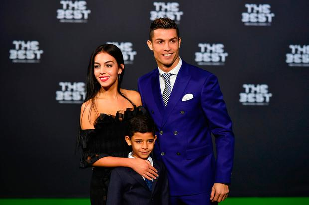 Real Madrid and Portugal's forward Cristiano Ronaldo poses with partner Georgina Rodriguez and his son Cristiano Ronaldo Jr as they arrive for The Best FIFA Football Awards 2016 ceremony