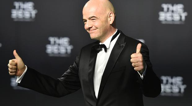 FIFA president Gianni Infantino poses as he arrives for The Best FIFA Football Awards ceremony, on January 9, 2017 in Zurich. / AFP / MICHAEL BUHOLZER (Photo credit should read MICHAEL BUHOLZER/AFP/Getty Images)