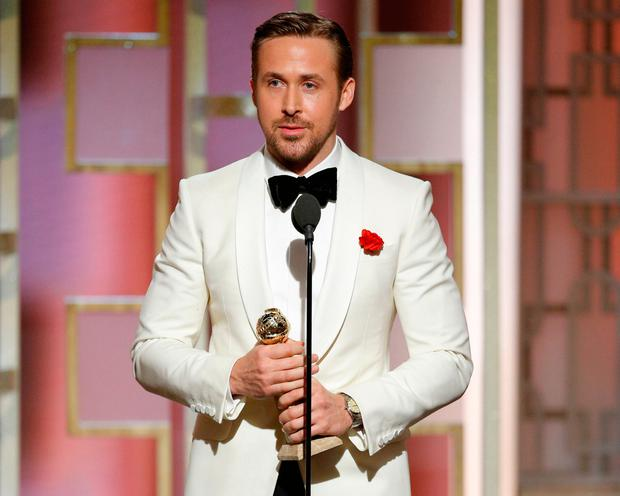 Ryan Gosling accepts the award for Best Actor in a Motion Picture - Musical or Comedy for his role in