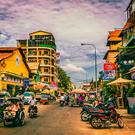 Phnom Penh, the land-locked and bustling capital of Cambodia, might not be an ideal place for an Irishman to wait out the heat - but it is a fascinating and vibrant city