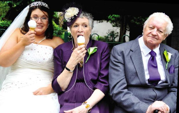 Alix pictured with her mum and dad at her wedding. The couple tragically passed away within months of one another in 2011 and 2012.