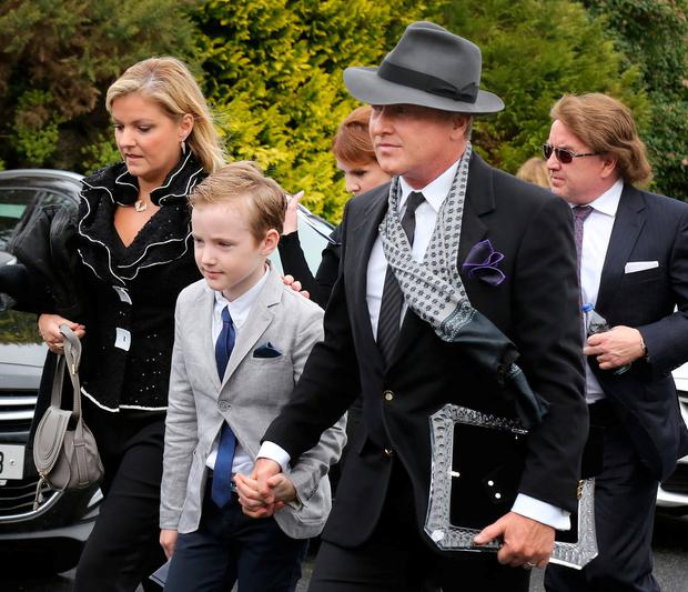 Michael Flatley arrives at St Moling's Church, Co Carlow, with his wife Niamh, son Michael Junior, and brother Patrick (rear right) for the funeral mass of Michael's mother, Elizabeth. Photo: Frank McGrath