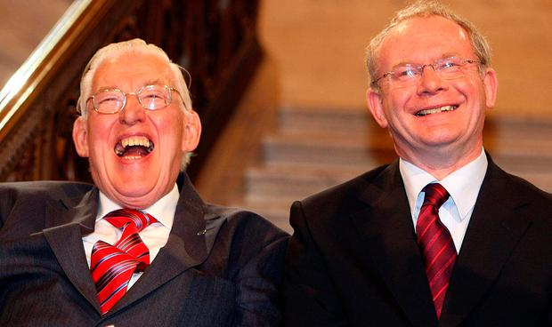 First Minister Ian Paisley and Deputy First Minister Martin McGuinness smile after being sworn in as ministers of the Northern Ireland Assembly in 2007. Photo: PA