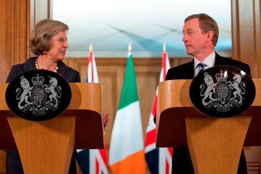 Taoiseach Enda Kenny and UK Prime Minister Theresa May last night vowed to work closely to resolve the crisis in the North. Photo: Stefan Rousseau/PA Wire
