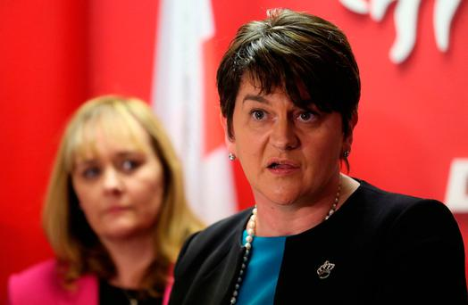 Democratic Unionist Party leader Arlene Foster speaks at the party's headquarters in Belfast with Northern Ireland Executive minister Michelle McIlveen (left). Photo: Niall Carson/PA Wire