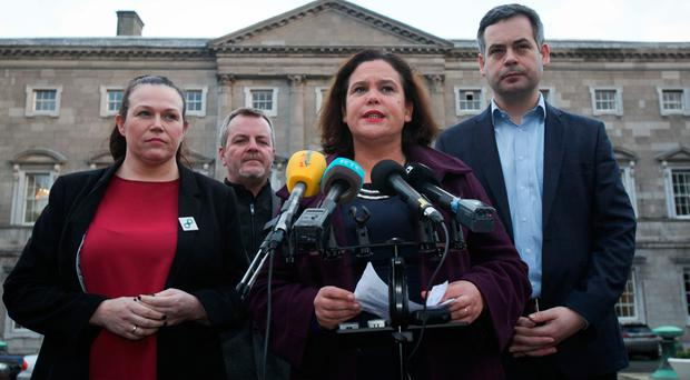 From left, Sinn Féin TDs Louise O'Reilly and Pat Buckley, Deputy Leader Mary Lou McDonald, and party Finance Spokesperson Pearse Doherty speak to reporters at Leinster House yesterday. Photo: Gareth Chaney/Collins