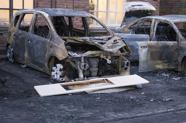 Damage done to cars outside terraced homes