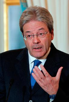 Italian Premier Paolo Gentiloni attends a press conference with French President Francois Hollande after their talks at the Elysee Palace in Paris.(AP Photo/Christophe Ena, file )