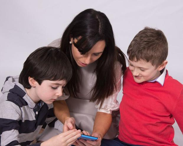 Lisa Marie Clinton working with other children using the technology