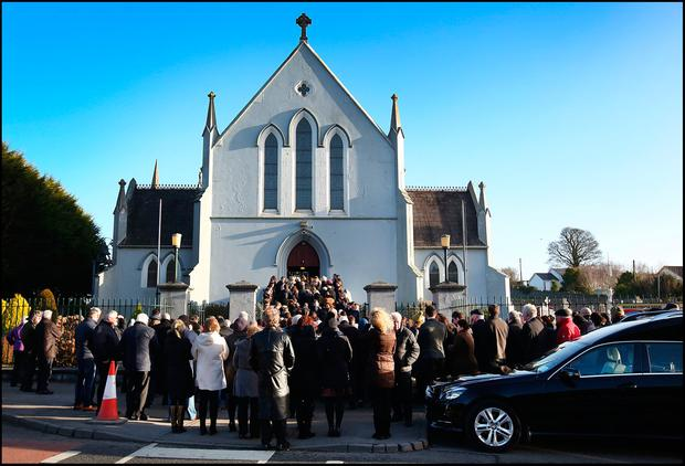 Mourners gather as the remains of Mona Clarke are brought to St Mary's Church Castleblaney Co Monaghan for Funeral Mass. Pic Steve Humphreys
