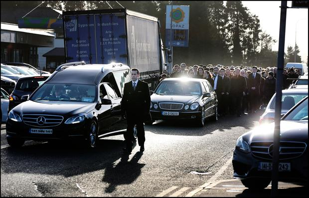 Mourners follow the remains of Mona Clarke as they are brought to St Mary's Church Castleblaney Co Monaghan for Funeral Mass. Pic Steve Humphreys