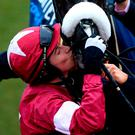 Bryan Cooper kisses Don Cossack after last year's Gold Cup victory. Photo credit: Tim Goode/PA Wire.