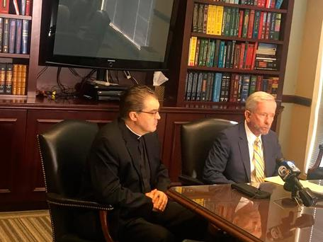 Fr John Gallagher and his lawyer appear at a press conference