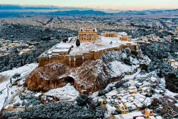 The ancient Acropolis following a rare snowfall in Athens, Greece. Photo: REUTERS