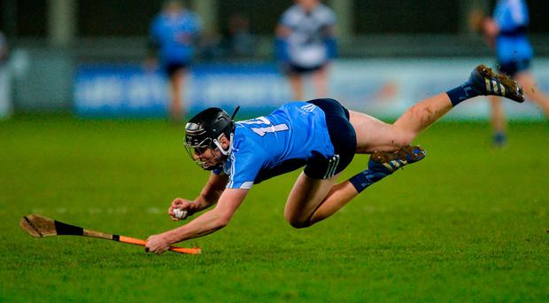 Dónal Burke of Dublin keeps possession while losing his balance during the Bord na Mona Walsh Cup Group 3 Round 2 match between Dublin and UCD at Parnell Park, Dublin. Photo by Piaras Ó Mídheach/Sportsfile