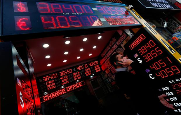 Boards showing the currency exchange rates of the US dollar and the Euro against Turkish lira are on display at a currency exchange office in Istanbul, Turkey. Photo: Reuters
