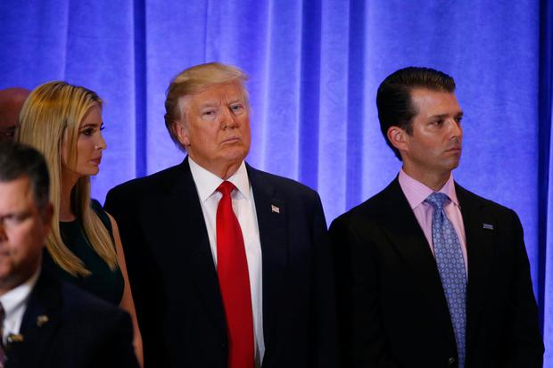 Donald Trump stands with son Donald Jr (right) and daughter Ivanka during yesterday's news conference at Trump Tower. Photo: REUTERS/Lucas Jackson