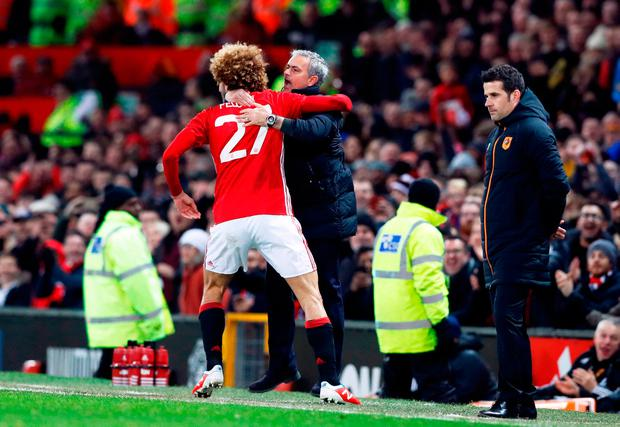 Manchester United's Marouane Fellaini celebrates scoring their second goal with manager Jose Mourinho. Photo credit: Martin Rickett/PA Wire.
