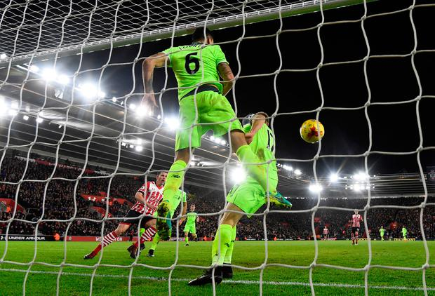 Liverpool defender Dejan Lovren helps to clear a Nathan Redmond shot off the line Picture: Reuters