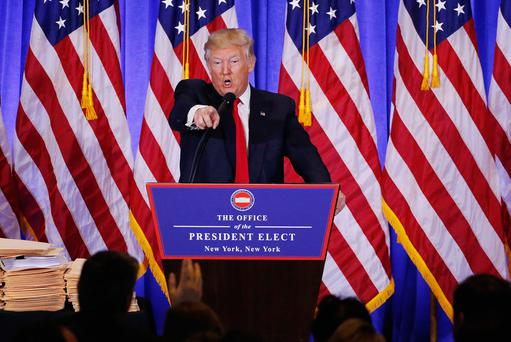 U.S. President-elect Donald Trump argues with CNN's Jim Acosta during a news conference in the lobby of Trump Tower in Manhattan New York City U.S