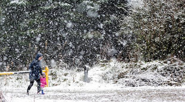 The biting cold begins: Wintry showers and snow 'extending to all areas this afternoon'
